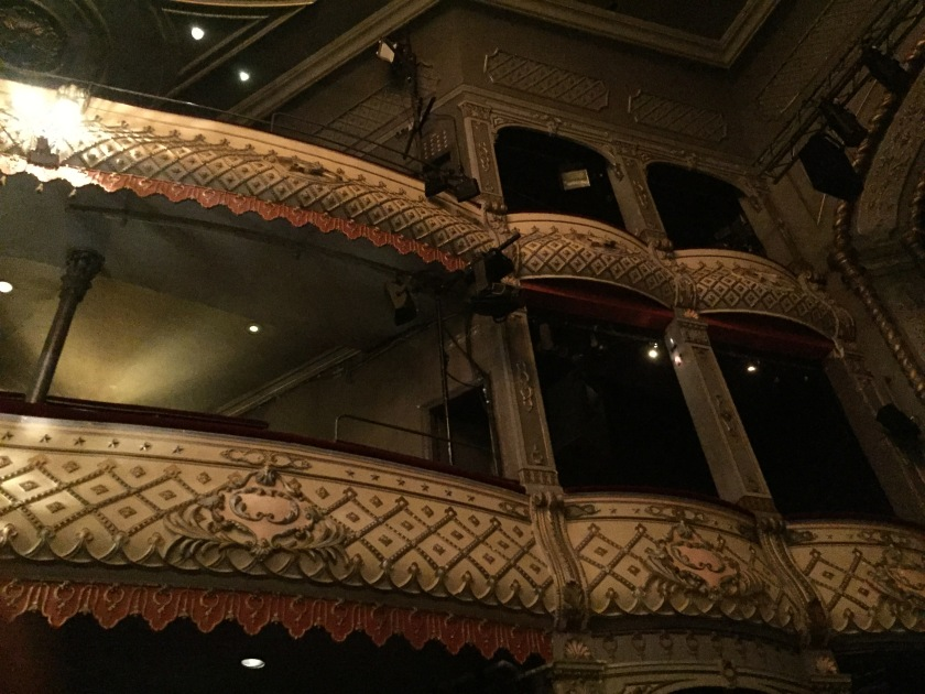 The ornately decorated balconies in the Old Vic auditorium, viewed from below in the stalls.