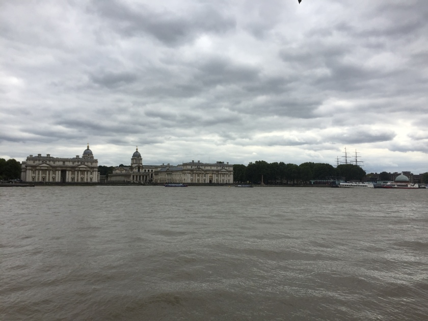 View across the River Thames from Island Gardens, looking at the Old Royal Naval College and Cutty Sark ship.