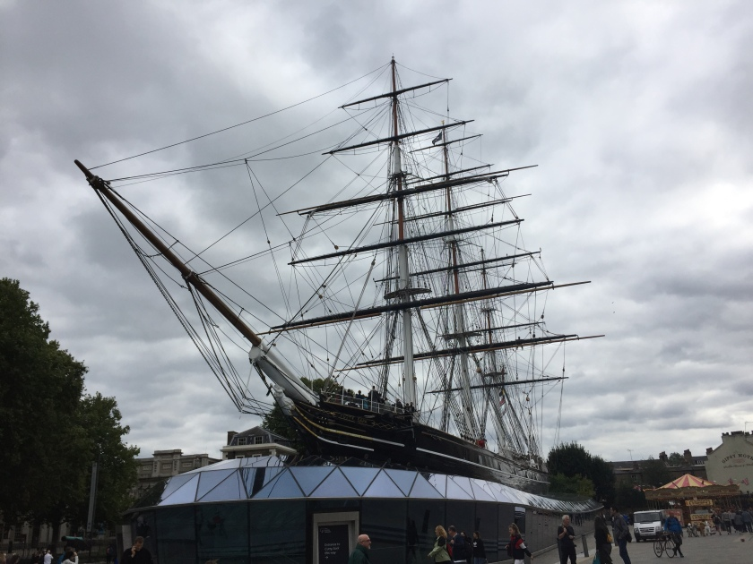 The Cutty Sark, a long ship with 3 huge rigging towers for the sails.