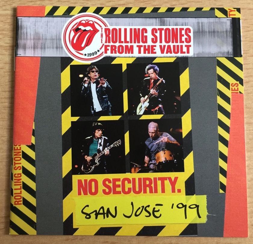 Booklet for the Rolling Stones CD and DVD entitled No Security, San Jose 99, part of their From The Vault series. 4 photos in the centre, arranged 2 by 2, show each of the band members performing at the concert.