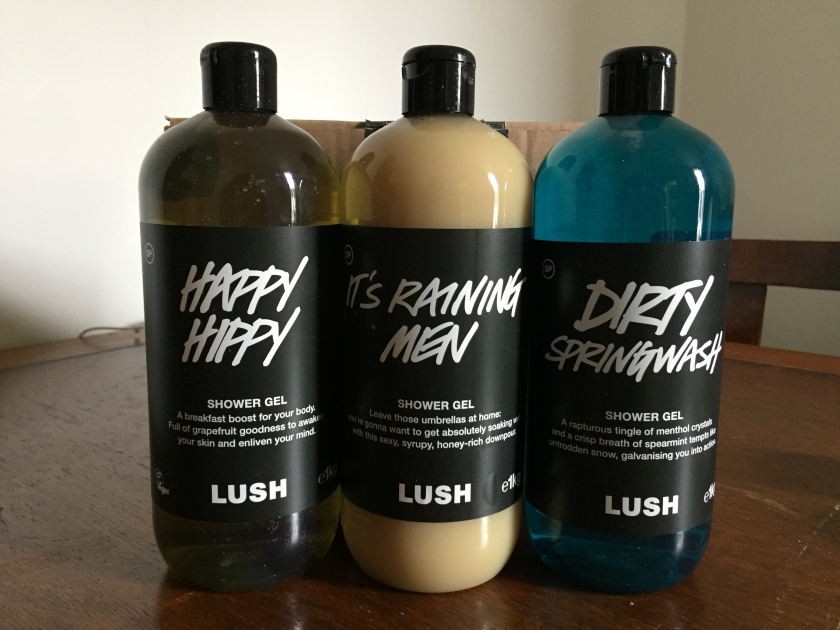 3 big bottles of Lush shower gel, called Happy Hippy, It's Raining Men & Dirty Springwash.