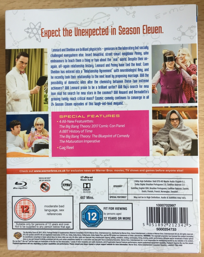 Back cover of the Blu-ray for The Big Bang Theory Season 11, with a synopsis of the show and photos from the episodes. Special features include featurettes called A History Of Time, The Blueprint Of Comedy and The Maturation Imperative, along with their 2017 Comic-Con panel and a gag reel.