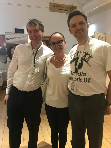 Glen, Galina and James posing and smiling together at the Aniridia Network Conference.