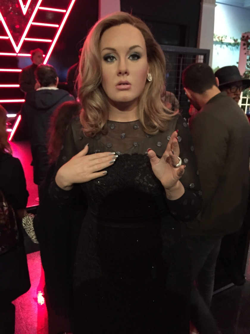 Madame Tussauds waxwork of Adele wearing a black dress.