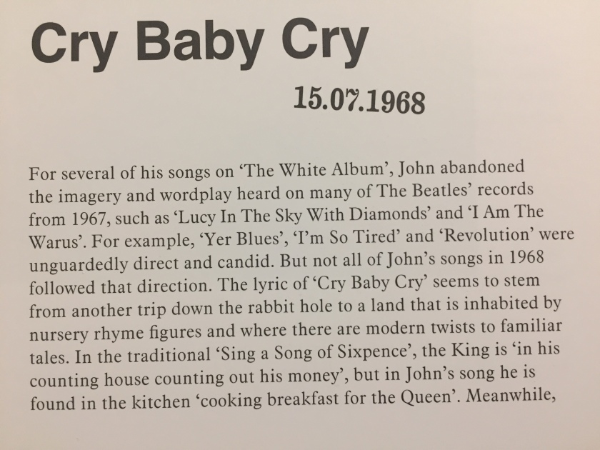 Extract from the book in the White Album box set by The Beatles, discussing the song Cry Baby Cry. The text includes a misspelling of I Am The Walrus, missing the letter L in the last word.