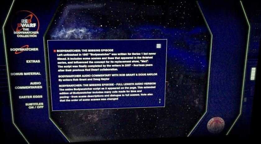 Menu for the Red Dwarf Bodysnatcher Blu-ray disc. Against a dark blue background on the left are options in white text for Bodysnatcher, Extras, Bonus Material, Audio Commentaries, Easter Eggs and Subtitles. The Bodysnatcher option is selected, revealing a large text box over a starry space background, with white text explaining the options for viewing the episode in its standard form with or without commentary, or a longer uncut version.