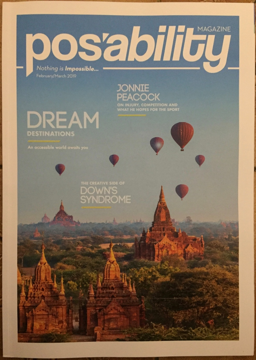 PosAbility Magazine, February & March 2019 edition. The cover image shows hot air balloons flying over a large city. Short headlines refer to dream destinations, Jonnie Peacock and Down's Syndrome. The strapline below the magazine's title at the top reads Nothing Is Impossible.
