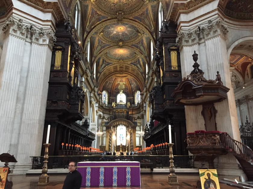 View inside St Paul's Cathedral, with highly ornate ceilings, wall decorations, statues and furnishings.