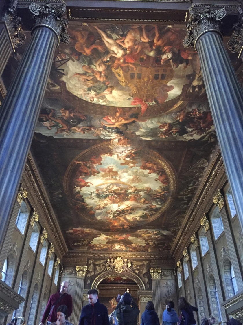 The highly detailed and ornate painted ceiling, stretching the length of the long hall in the Old Royal Naval College.
