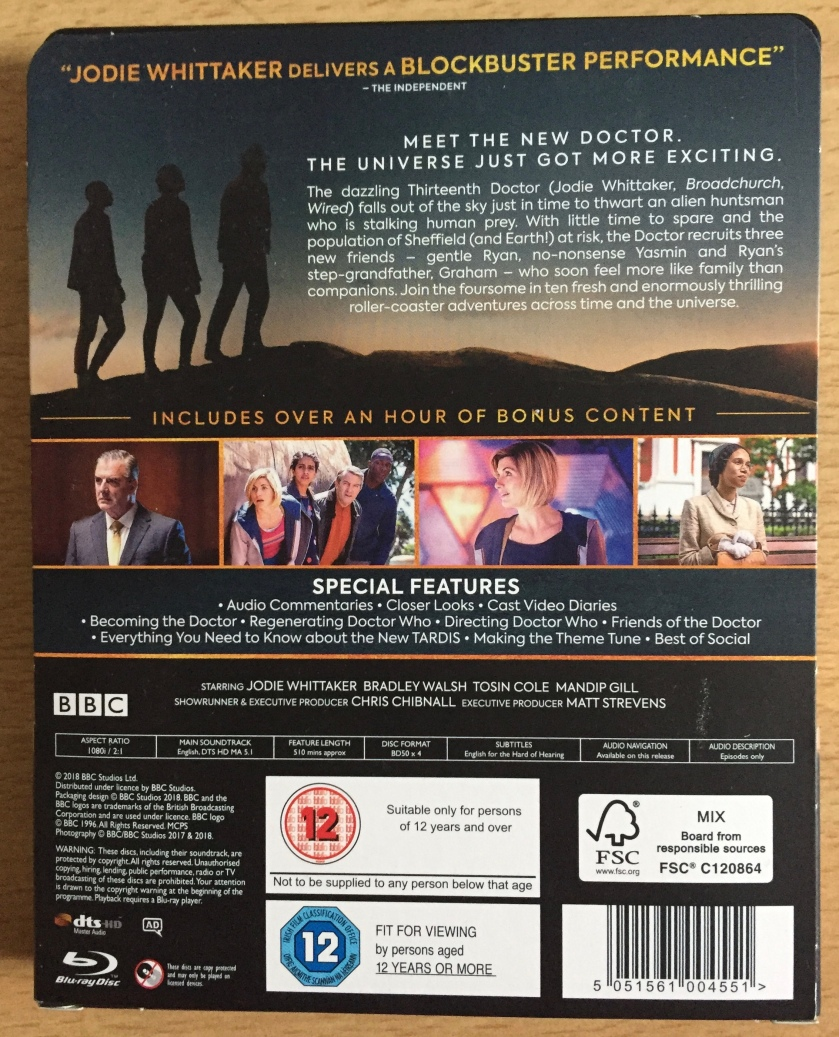 Rear cover card for the Blu-ray steelbook of Doctor Who Series 11, giving a description of the show along with photos showing the Doctor, her companions and other characters.