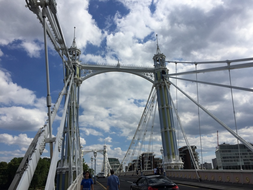 Albert Bridge, a road bridge across the Thames. It is very similar to a suspension bridge, with cables from ground level up to the top of 2 very tall ornate pillars that support the bridge, one on on each side.