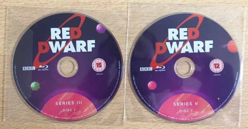 Replacement Blu-ray discs for the Red Dwarf box set, for series 3 disc 1 and series 5 disc 1.
