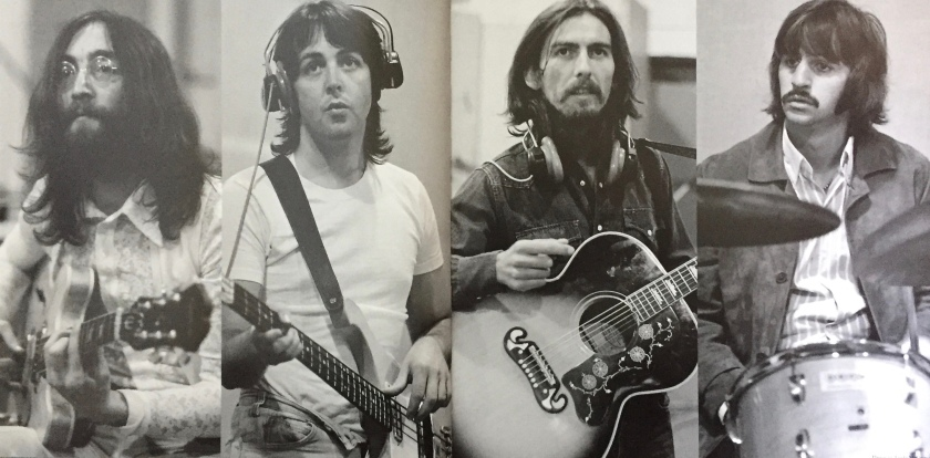 A set of 4 black and white photos, spread across 2 large book pages, showing the 4 members of the Beatles playing in the studio, with Ringo on the drums while the others are playing guitars.