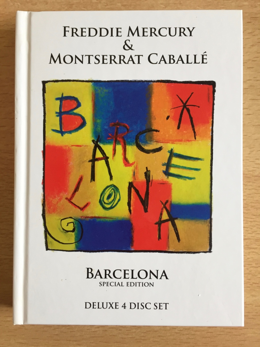 Cover of the 2012 Special Edition Deluxe 4-disc set of the Barcelona album. The image shows the handwritten letters of the word Barcelona spread over a background of squares and rectangles painted in yellow, blue, orange and red.