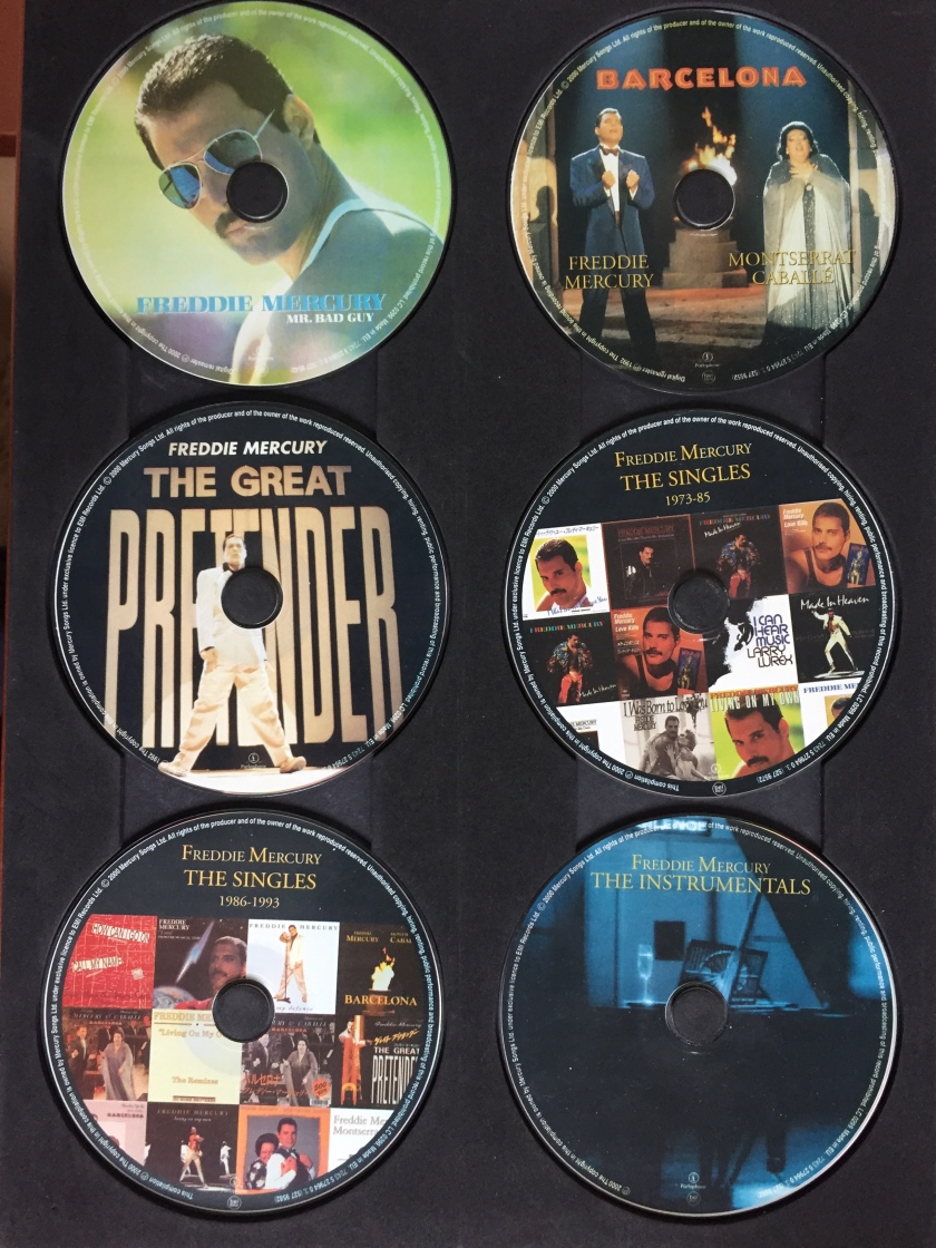 The first 6 discs in the Freddie Mercury Solo Collection, 1 disc each for the Mr. Bad Guy, Barcelona and Great Pretender albums, 2 discs for the singles, and a disc of instrumentals. The 3 album discs have the album artwork on them, the singles discs each have a collage of the single covers, and the instrumentals disc has a photo of a piano on it.