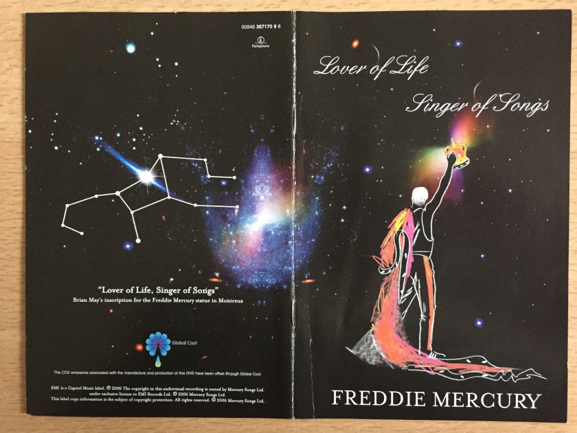 DVD cover for Freddie Mercury, Lover Of Life, Singer Of Songs. Features a drawn image of Freddie wearing a long flowing robe that drapes across the ground, while holding a crown in the air, looking out into space, surrounded by stars.