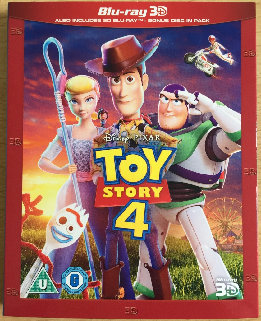 Blu-ray cover for Toy Story 4, showing Woody, Buzz, Bo Peep and Forky standing on a grassy hill with a ferris wheel in a fairground visible in the distance.