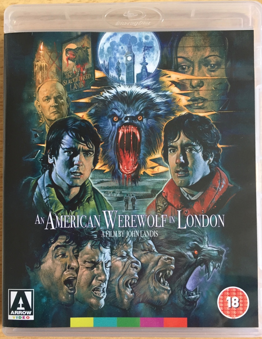 Blu-ray cover for An American Werewolf In London, featuring a colourful painting showing the head of a roaring werewolf surrounded by headshots of the film's main characters. At the bottom, a sequence of 5 headshots illustrates the transformation from human to werewolf.