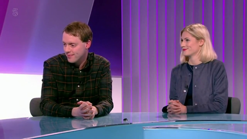Glen and Krissie sitting next to each other at a glass desk in the Channel 5 News studio, with a purple backdrop behind them.