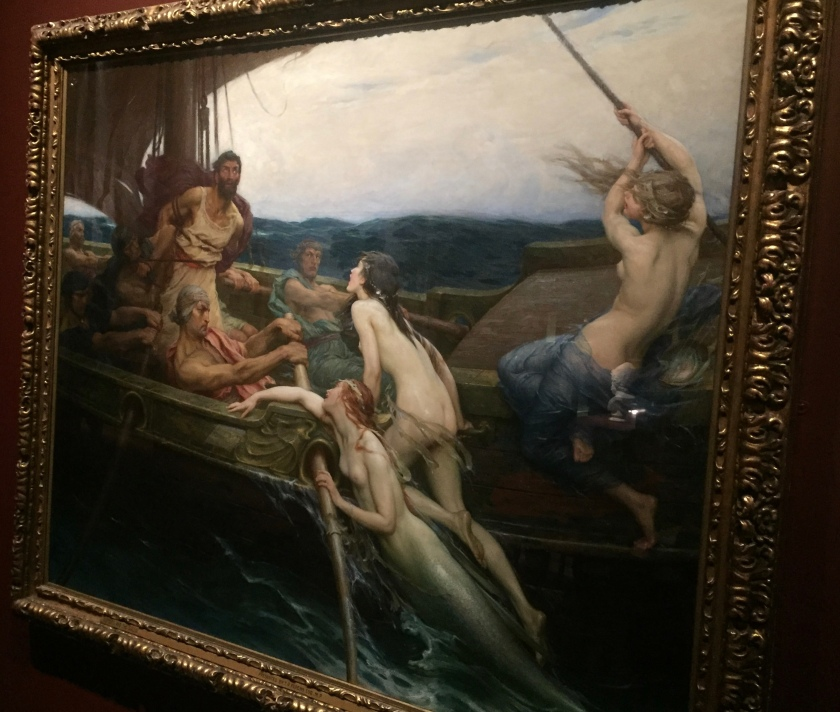 Painting entitled Ulysses and the Sirens. It shows Ulysses, a tall bearded man, tied to the mast of a ship being rowed by a group of men. His eyes are wide open, transfixed by the beauty of the three naked mermaids who are trying to climb on to the boat to reach him.
