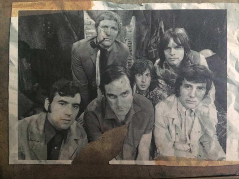 Black and white photo of the Monty Python team on the box of the Blu-ray box set. At the back are Graham Chapman, Eric Idle and Terry Gilliam, while in front of them are Terry Jones, John Cleese and Michael Palin.