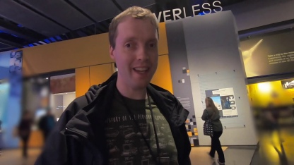 Glen smiling at the camera while in the Driverless exhibition at the Science Museum.