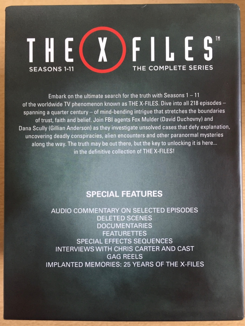 Back cover of the Blu Ray Box Set for The X Files, with a brief synopsis of the show, and a list of special features, including audio commentaries, deleted scenes, documentaries, special effects, interviews with Chris Carter and cast, gag reels and more.