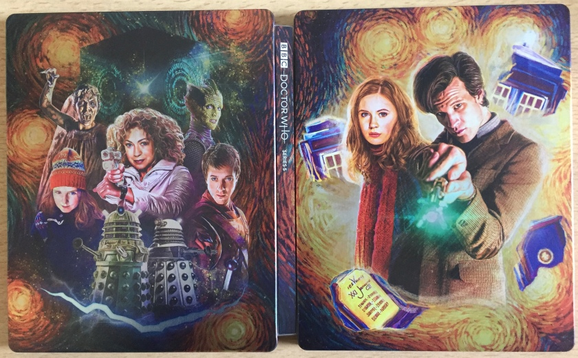 The unfolded cover of the Doctor Who Series 5 Blu-Ray Steelbook. The painted artwork shows The Doctor and Amy Pond on the right, with partial images of the Tardis swirling around them, while on the left is a selection of other characters, including Rory, River Song, young Amy and the Daleks.