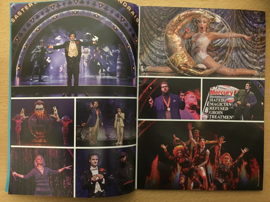 2 pages from the Magic Goes Wrong souvenir programme, with a selection of photographs from the show. In one photo, a lady does the splits while a dummy in a shiny gold outfit rolls past her in a hoop. In another, a newspaper headline reads Hated Magician refused Groin Treatment.