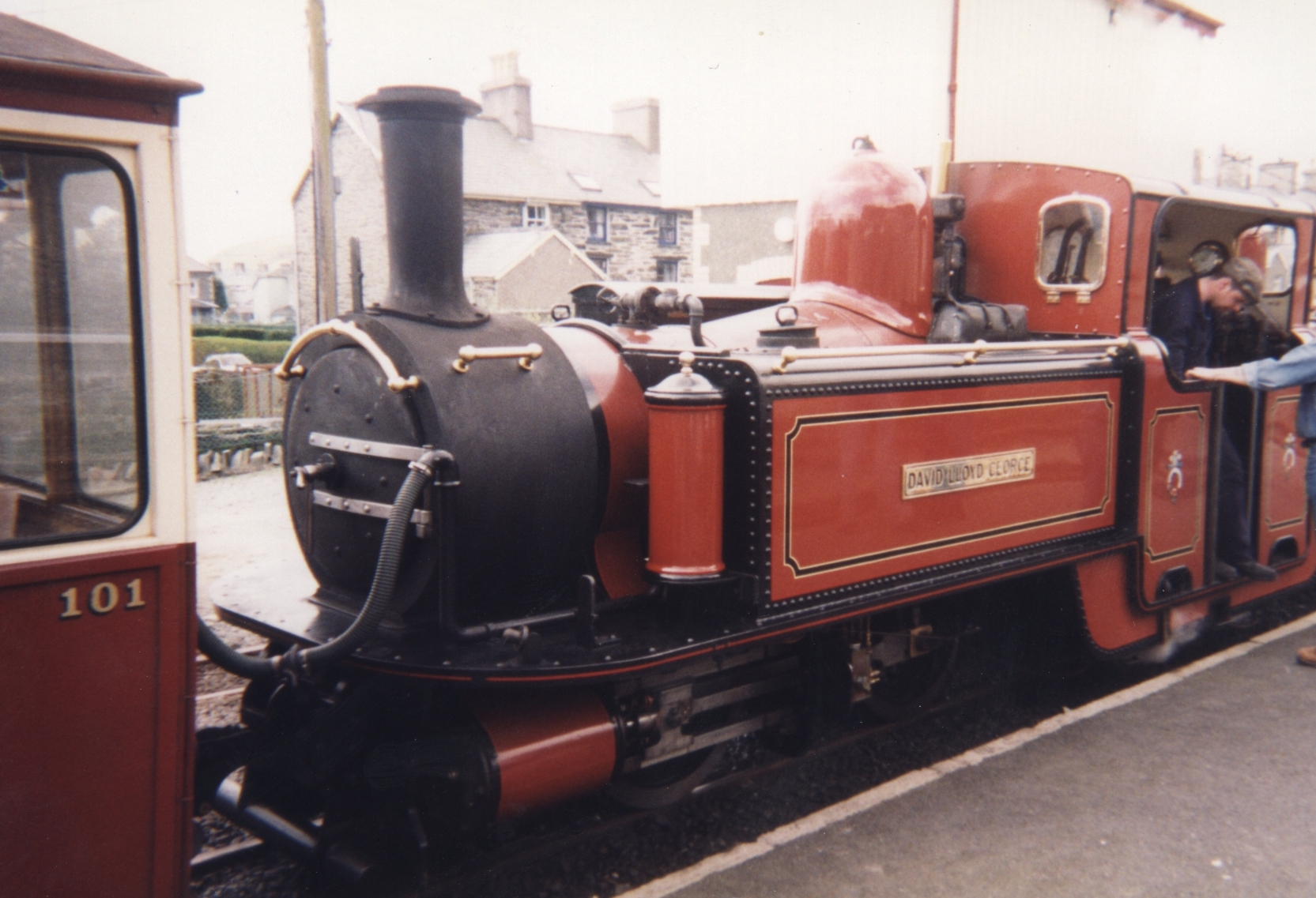 Red steam train, with the name David Lloyd George displayed on a metal panel on the side of the locomotive.