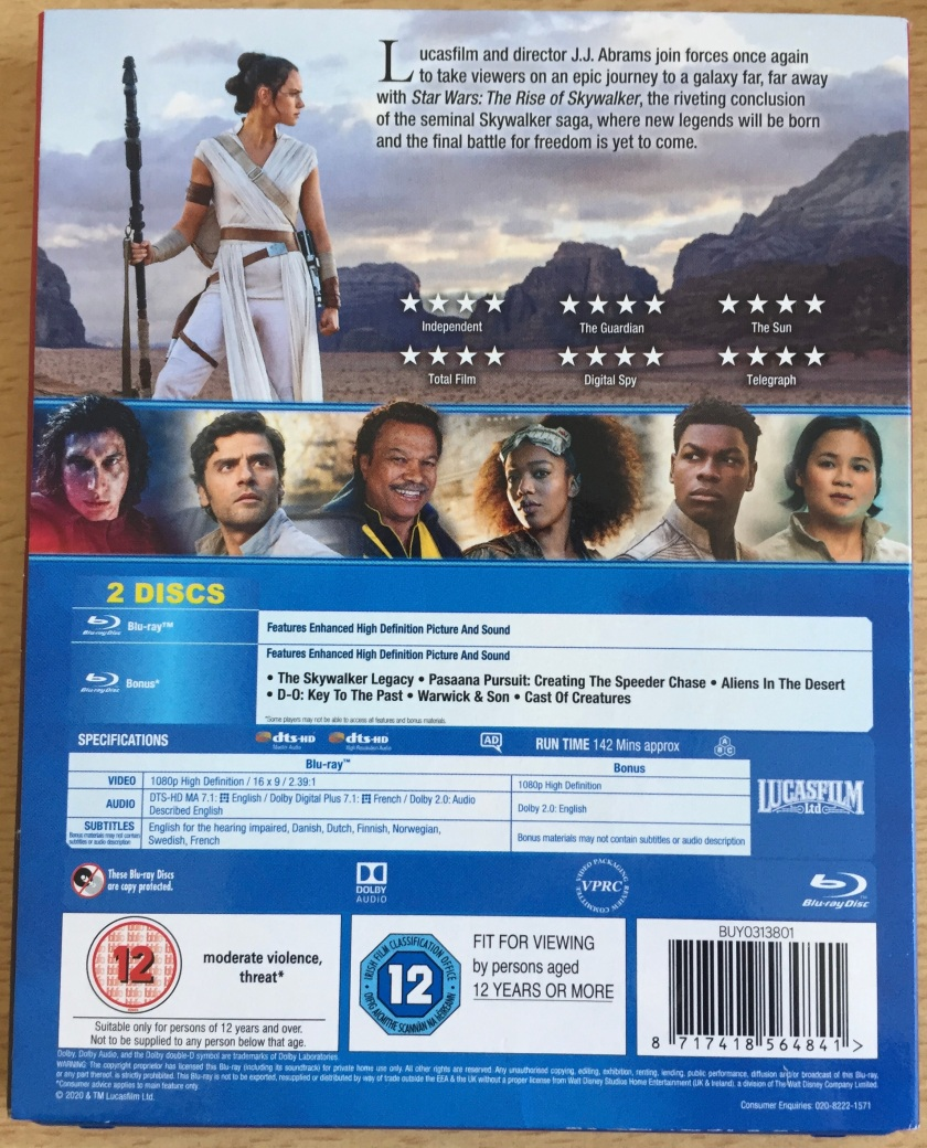 Blu-ray back cover for Star Wars Episode 9, The Rise Of Skywalker, showing Rey dressed in a white dress and holding a long staff as she observes the desert around her, below which is a row of photos of other characters.