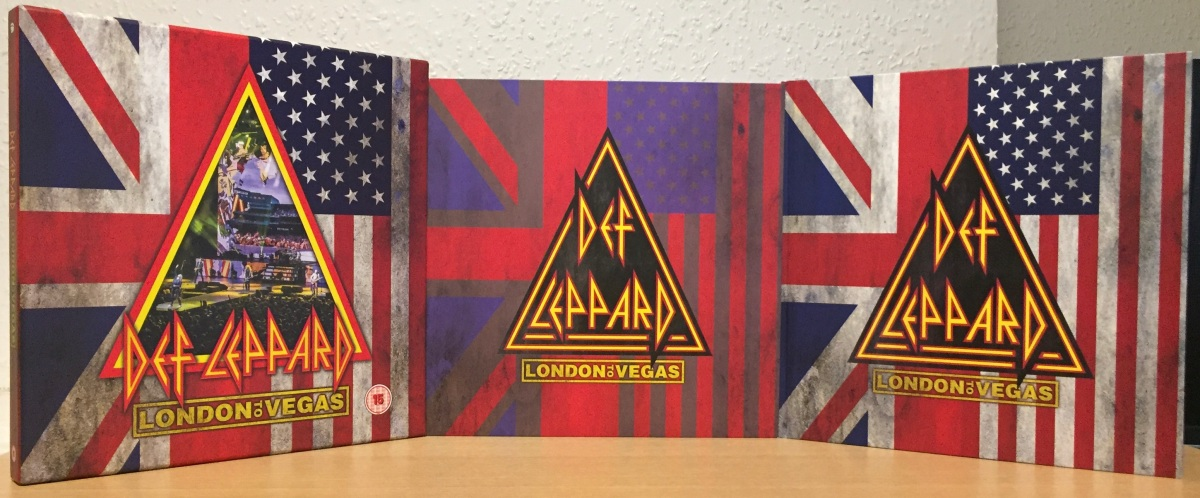 Def Leppard London To Vegas Box Set, shown in its component parts - the outer box on the left, the inner box containing the discs, and the hardback book. The backgrounds of all of them show half of the UK and USA flags next to each other, while a large triangle in the middle shows the Def Leppard logo and the London To Vegas title.