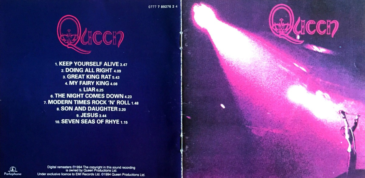 Booklet cover spread for Queen's self-titled debut album. The left page shows the back cover, with the track listed in white text on a dark blue background. The front cover on the right shows Freddie Mercury on stage, holding a microphone stand above his head, while a big spotlight shines down on him. The lighting has a pink and purple hue to it.