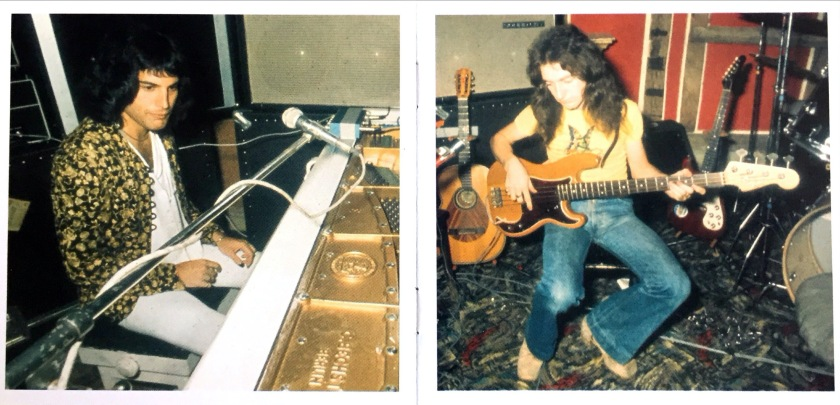 A 2-page spread from the Night At The Opera CD booklet, one photo on each page. On the left, Freddie Mercury sits in front of a microphone, wearing a leafy-patterned jacket over a white shirt and white trousers. On the right, John Deacon sits playing the bass guitar, wearing a yellow t-shirt and blue jeans