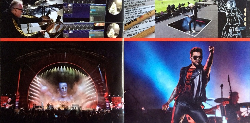 2-page spread from the Live Around The World album booklet by Queen and Adam Lambert. The left page shows a photo of the stage from a distance, with spotlights from all angles around its upper archway, and the head and shoulders of Frank The Robot filling the back screen. The right page shows a photo of Adam striking a powerful pose, punching the air high in front of him