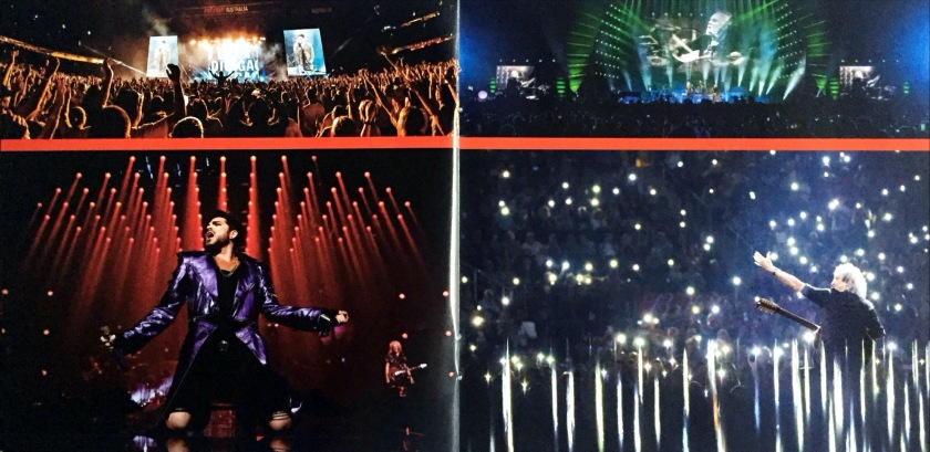 2-page spread from the Live Around The World album booklet by Queen and Adam Lambert. The left page shows Adam striking a star-like pose with arms out to the sides and legs apart as he sings. The right page shows Brian gesturing to the crowd as he sits among a beautiful universe of torchlights from their phones.