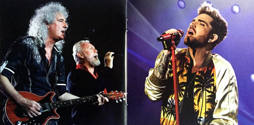 2-page spread from the Live Around The World album booklet by Queen and Adam Lambert, showing Brian and Roger singing on the left page, and Adam singing on the right.