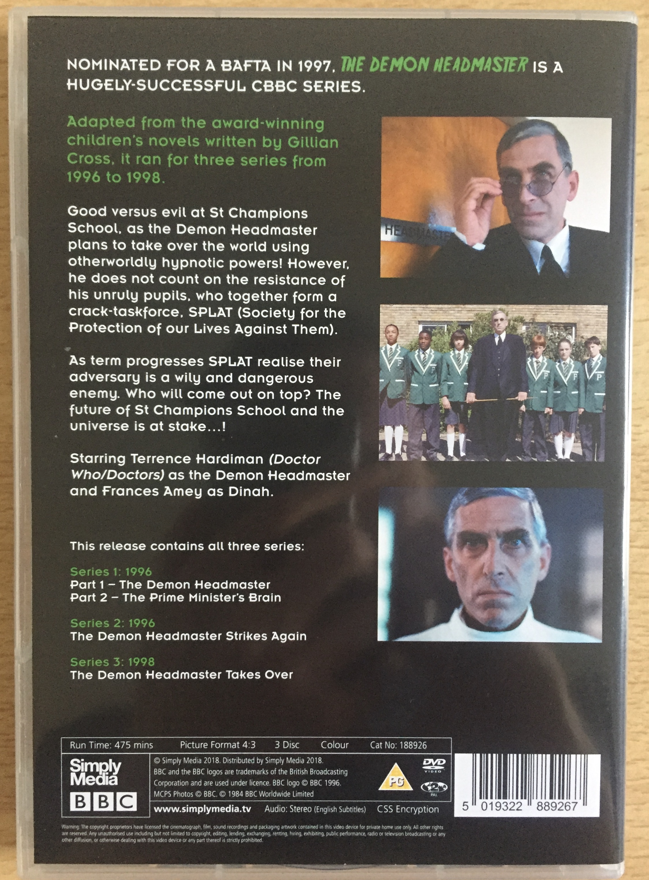 Back cover of the DVD for The Demon Headmaster. Alongside the text are 3 photos from the show featuring the title character, one of him looking over his glasses, one standing in front of a group of his pupils, and one a close-up of him staring straight ahead.