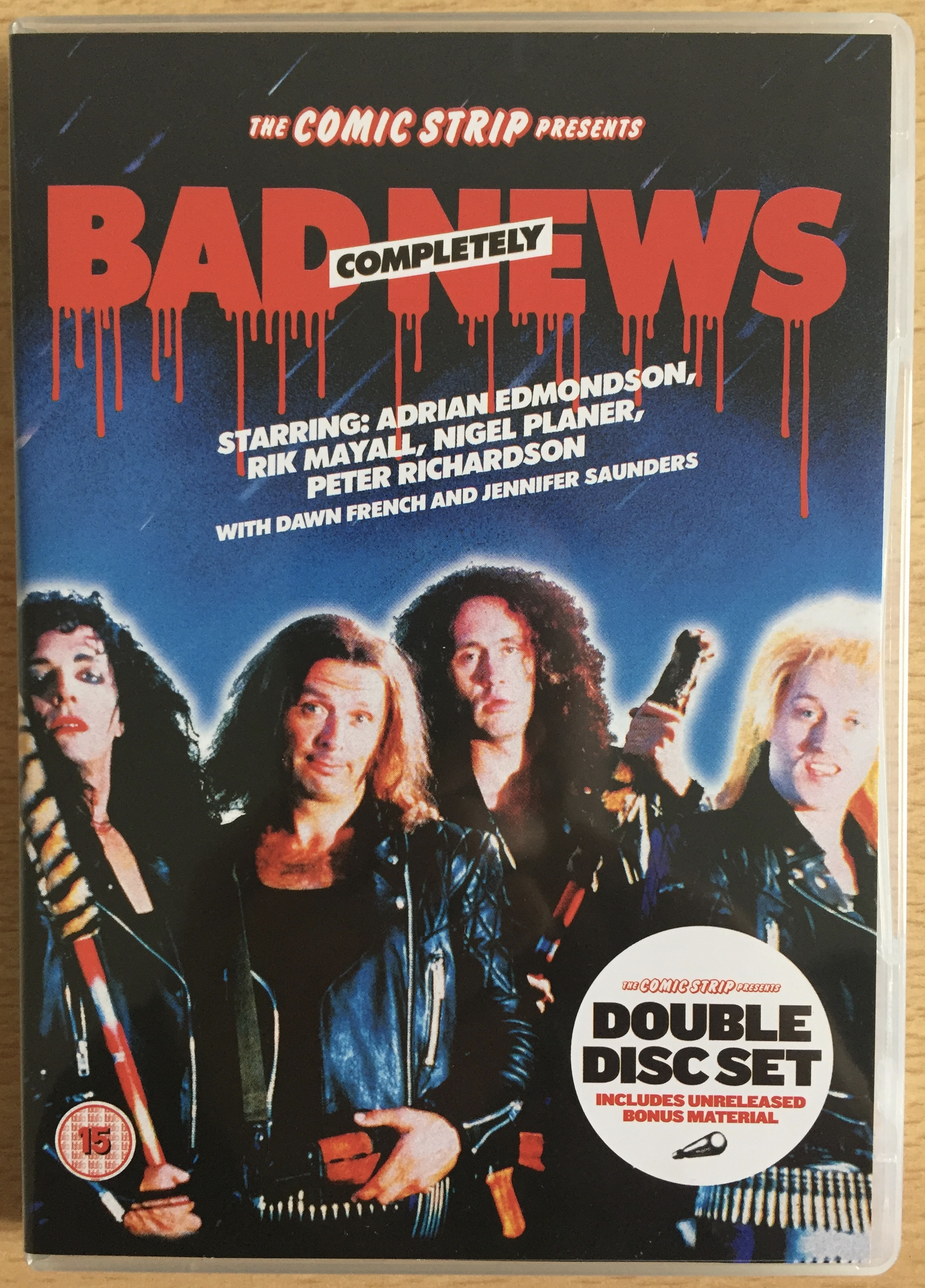 DVD cover for The Comic Strip Presents Completely Bad News, showing the 4 members of the spoof metal band.