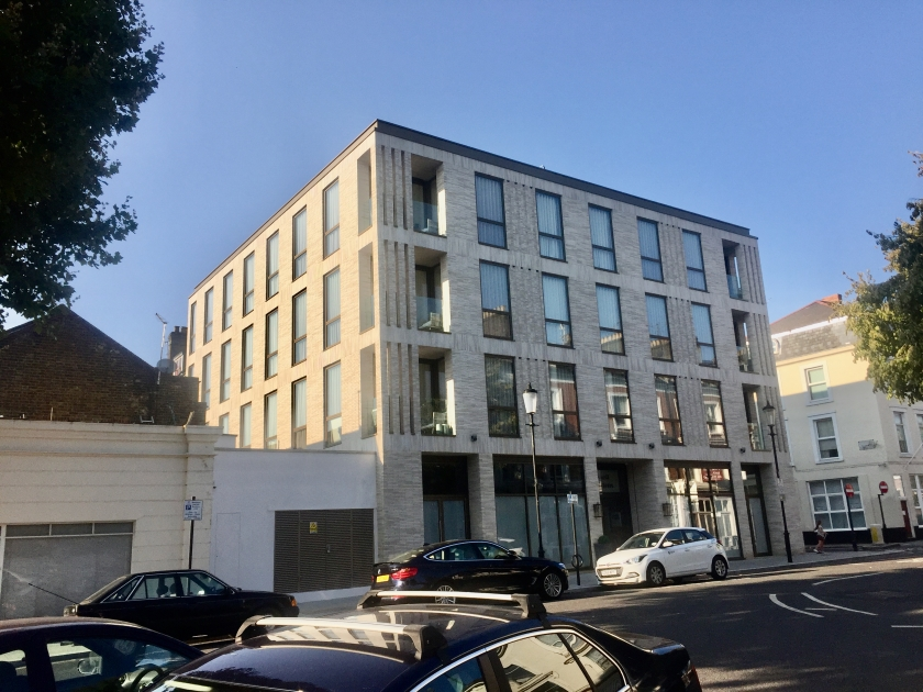 Another angle of the large, square, 4 storey building at 54 Russell Gardens.