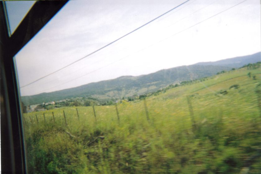 Scenic view of fields and hills from the train in Ronda.