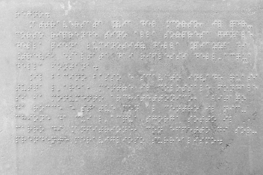 Sign in Braille explaining the history of the Trevi Fountain in Rome, Italy.