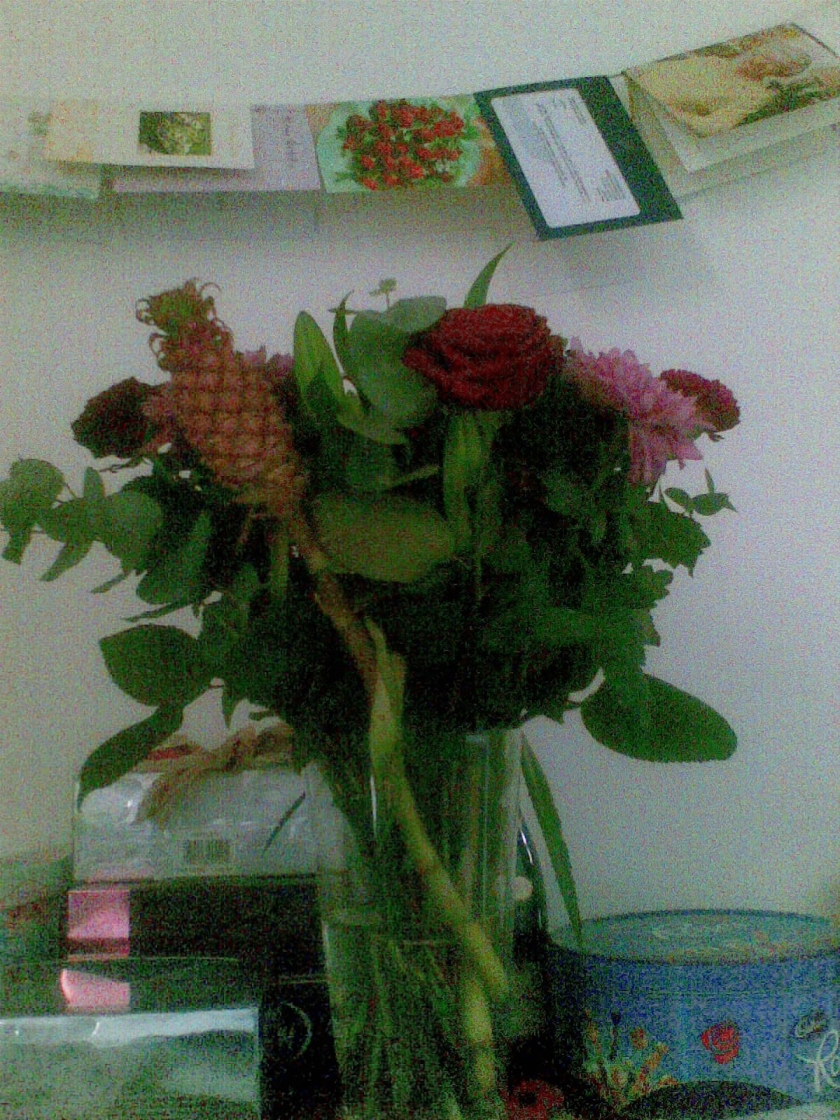 A bouquet of red and pink flowers for my Nan's 100th birthday,