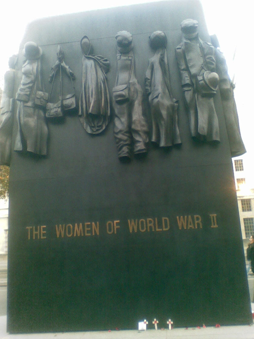 The Women of World War 2, a tall black monument featuring representations of the outfits worn by females serving in the conflict.