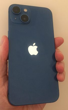 Blue iPhone 13, with an Apple logo in the centre, and 2 cameras positioned diagonally in the top-left corner.